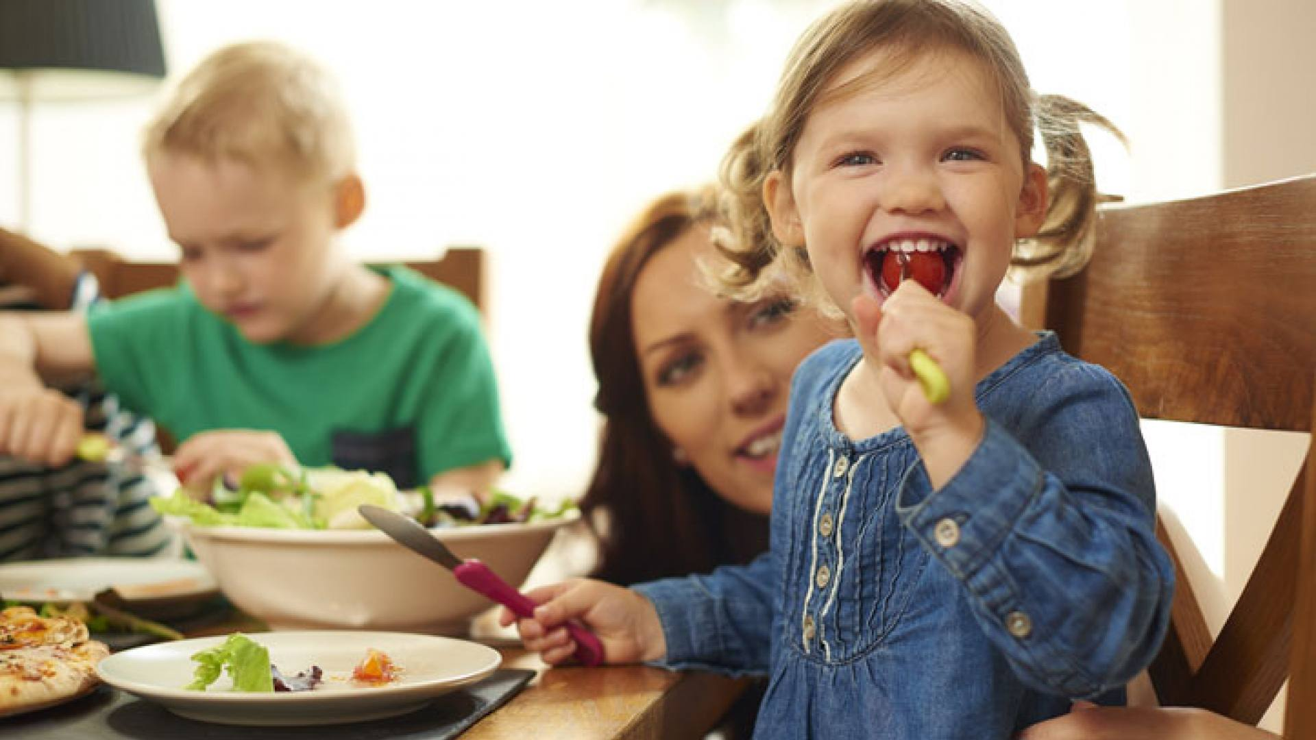 Grimsby - Baby girl happily eating with her family